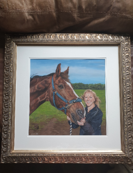 Framed horse portrait of a beautiful bay called Cruz and his owner standing in a field. Framed in a beautiful ornate gold frame