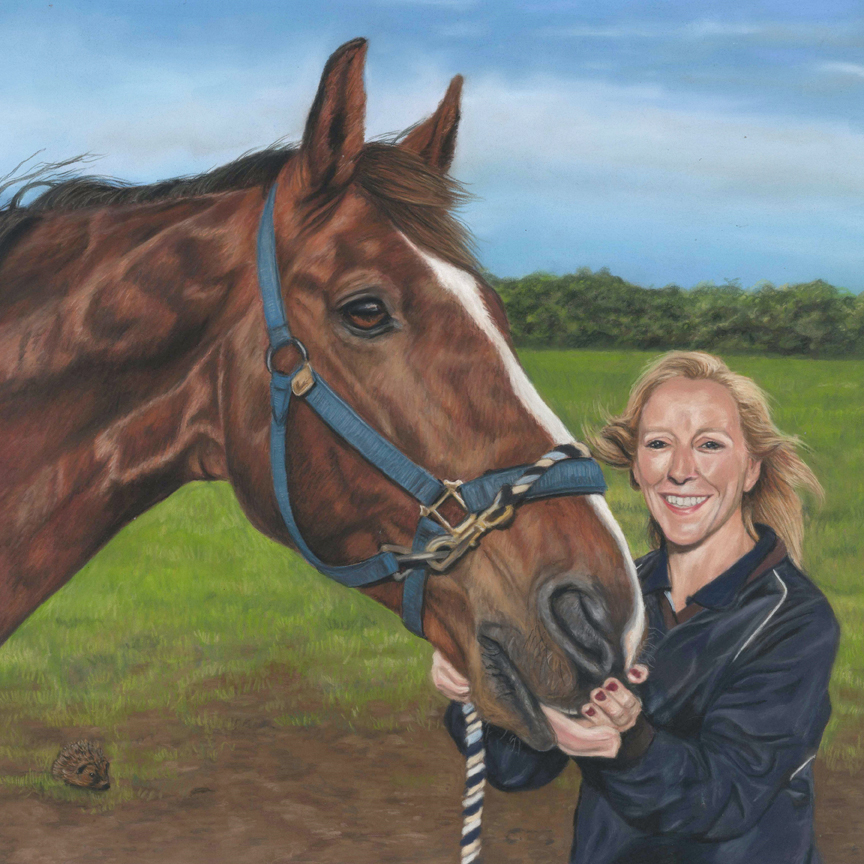 Pastel portrait of a horse standing next to his owner, a lady who is wearing a navy blue top. Blue sky with some clouds and trees and field behind.