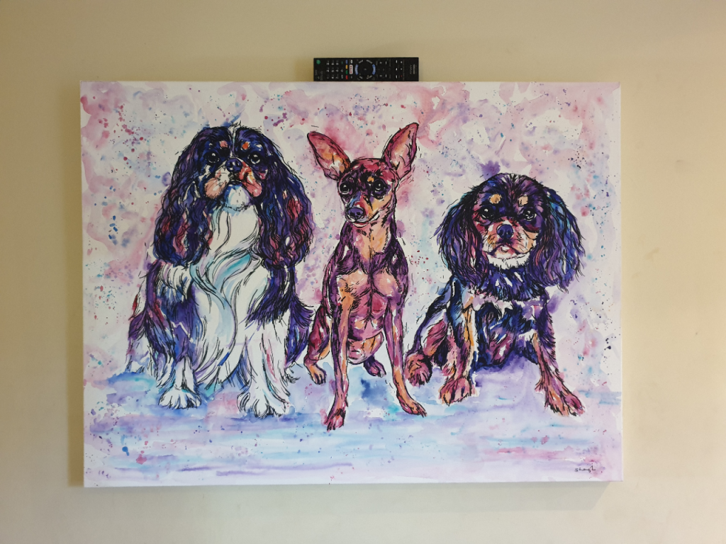 Melody, Chico and Urchins Jolly Splashes pet portrait hanging on the wall